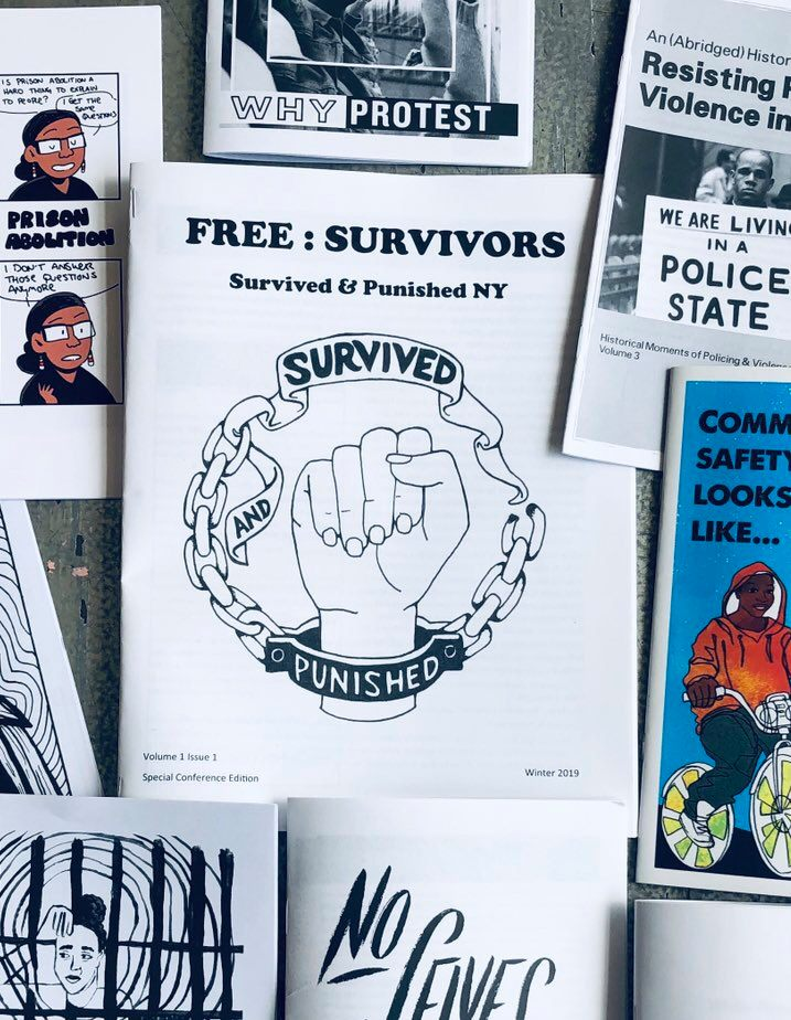 A picture of the first issue of Survived and Punished NY magazine surrounded by other publications posted to a cork board.